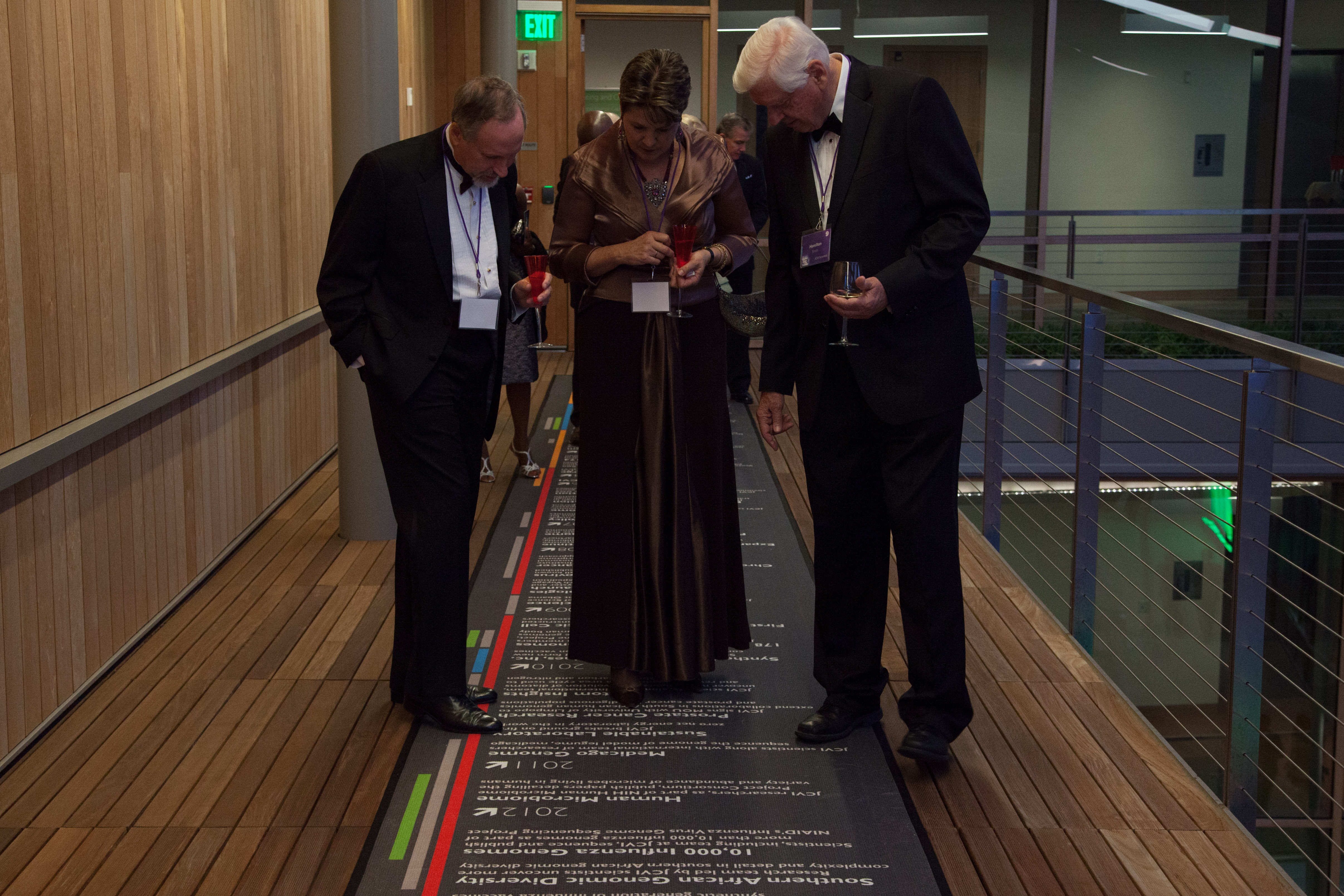 Nobel Laureate Hamilton Smith (right) walks gala attendees through JCVI advances.