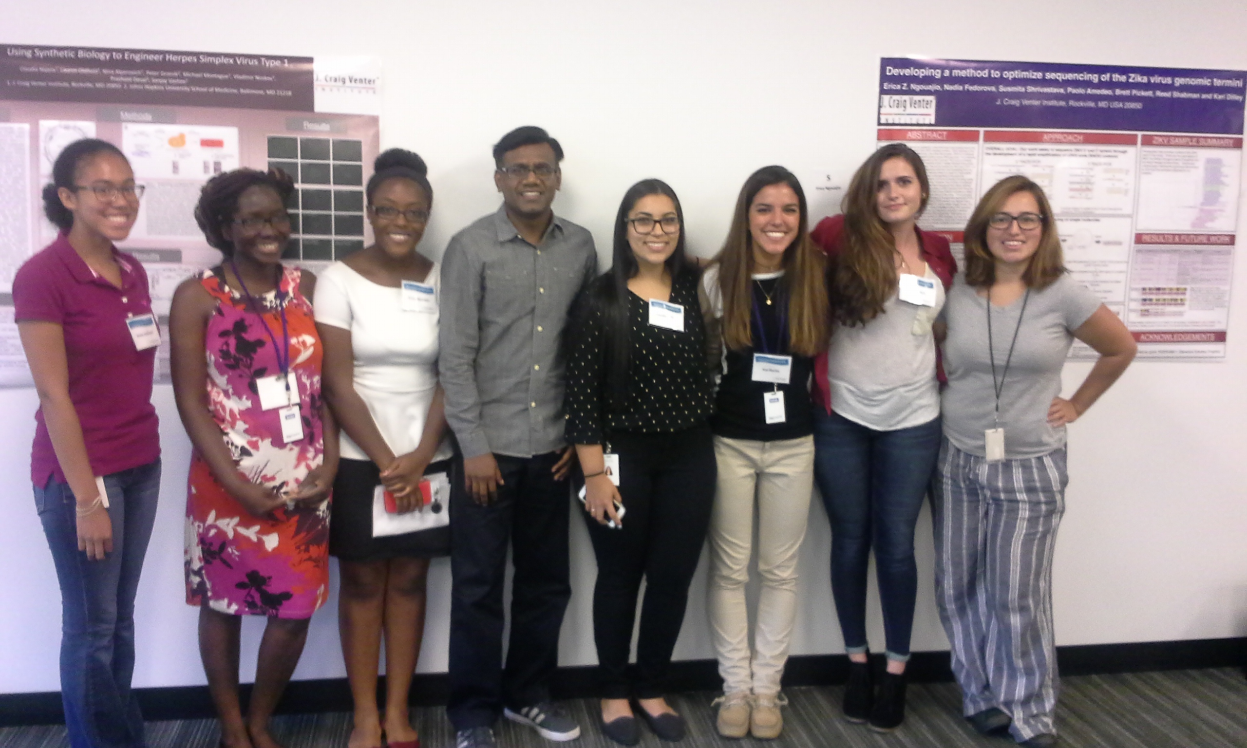 GSP interns Emily Samuels, Rolande Tra Lou, Erica Ngouajio, Raja Venkatappa (mentor), Claudia Najera, Kat Rocha, Tayah Bolt (from La Jolla) and Kenya Platero gather at JCVI Rockville's poster session.