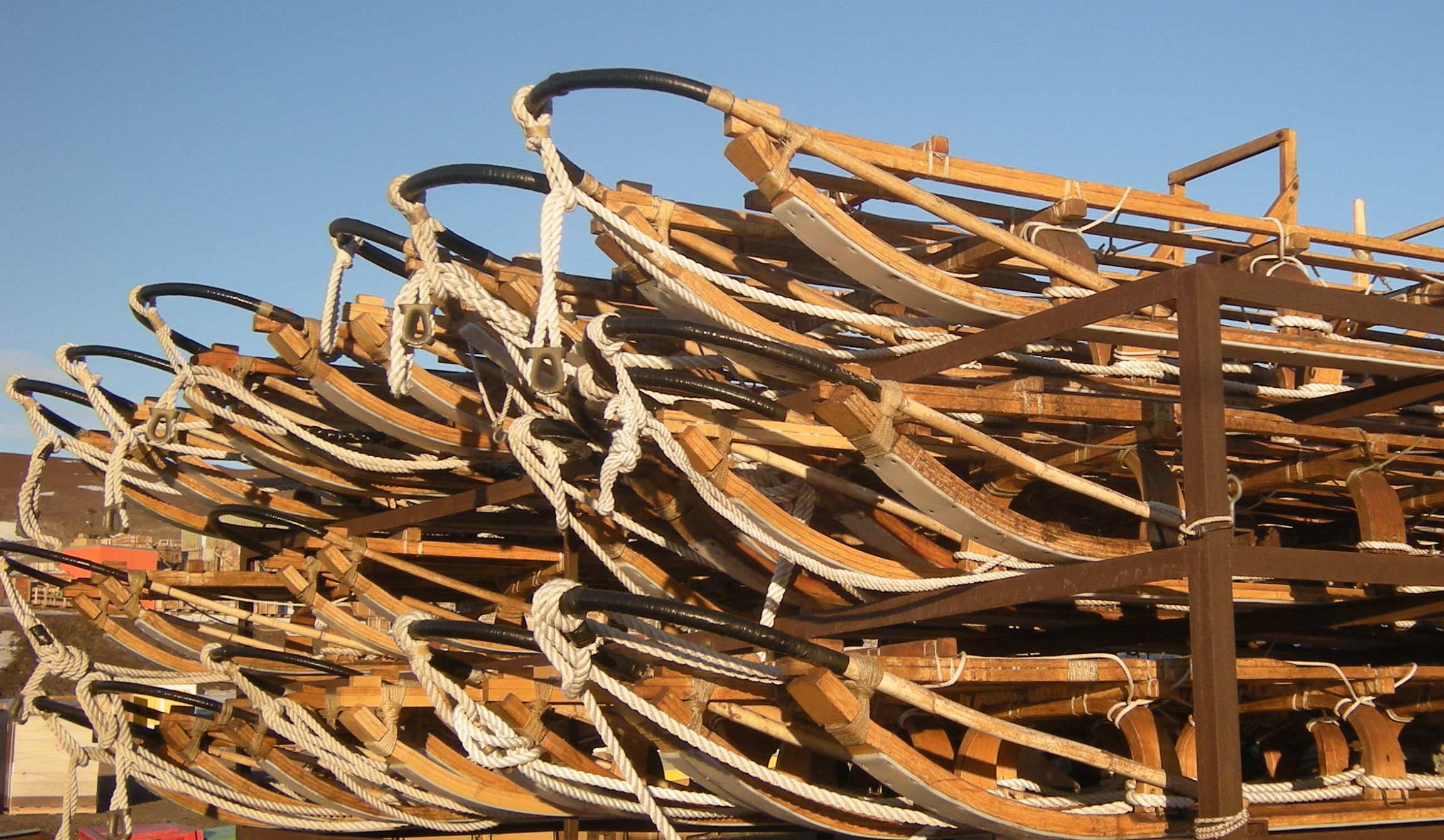 A pile of Nansen sleds next to the Berg Field Center
