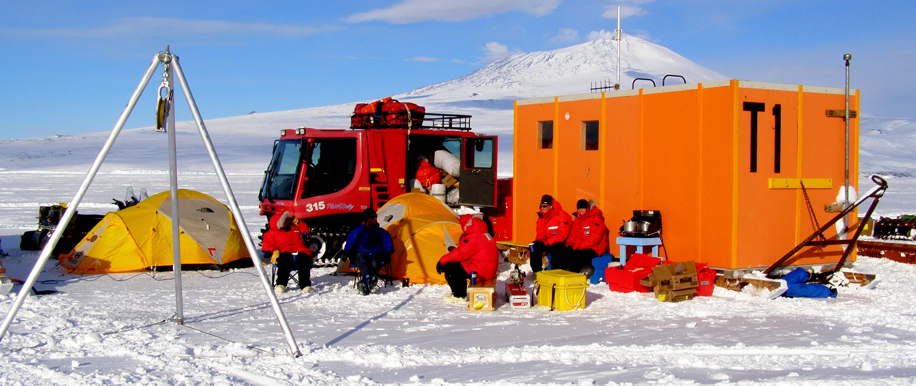 Enjoying some hot beverages out of the wind at Station II ice camp