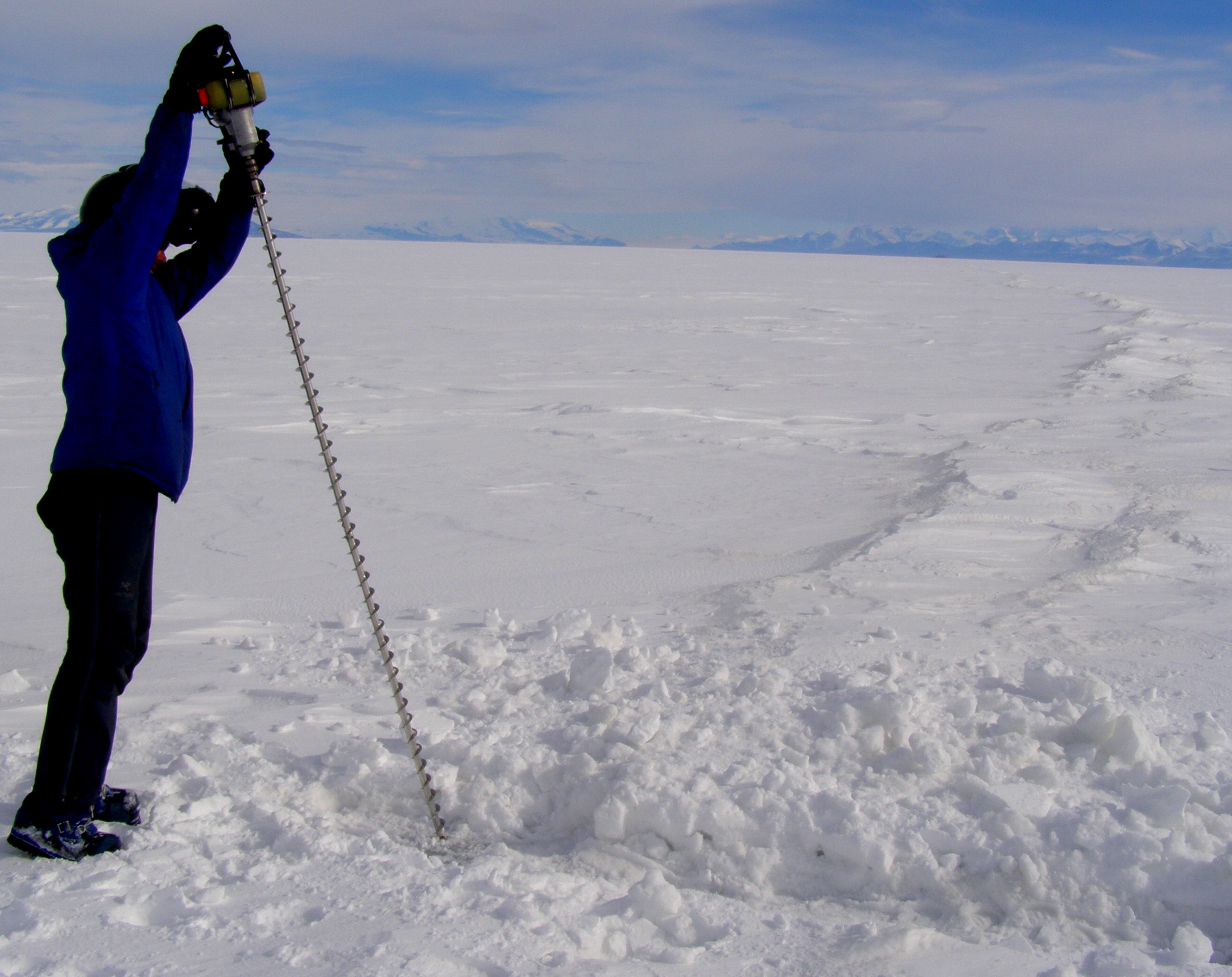 Matt drills to test the ice thickness across a crack