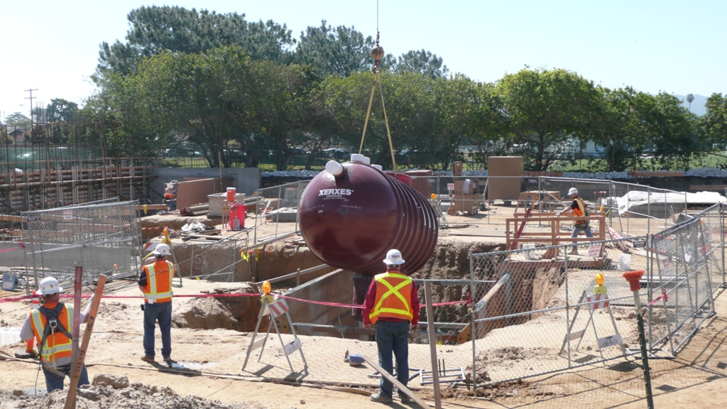 5500 gallon rainwater storage tank is lowered into place